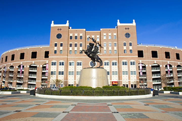 Photo of University Center B and the Unconquered statue